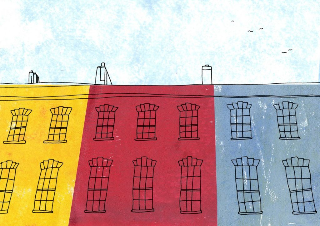 Row of three houses, yellow, pink and blue.